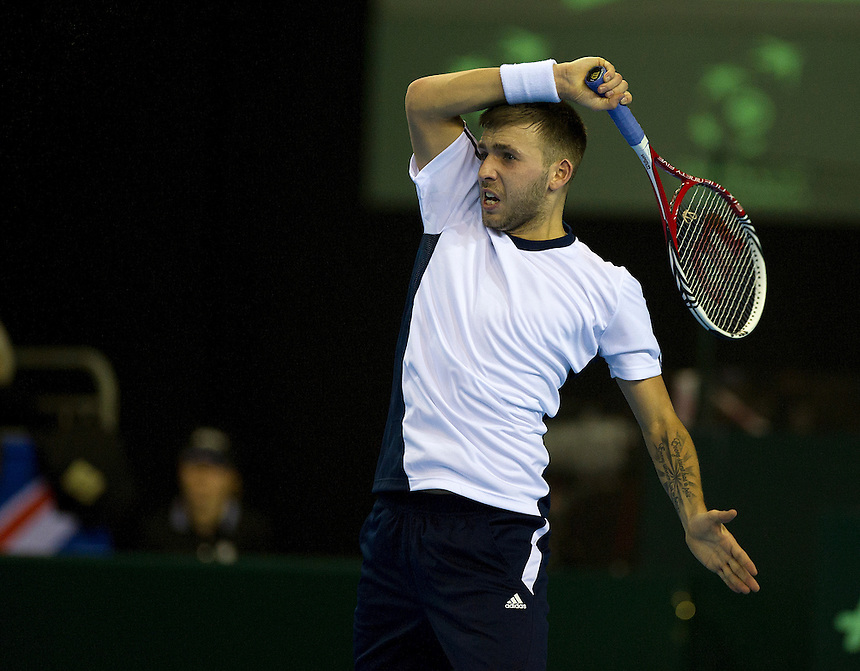 Great Britain's Dan Evans in action today during his defeat by Russia's Dmitry Tursunov in their singles match today - Dimitry Tursunov def Dan Evans 6-4 6-7 (5-7) 6-4 5-7 6-4.. - (Photo by Stephen White) ..International Tennis -  - Davis Cup by BNP Paribas - Europe/Africa Zone Group I Second Round - Great Britain v Russia - Day 1 - Friday 5th April 2013 - Ricoh Arena - Coventry - UK..© CameraSport - 43 Linden Ave. Countesthorpe. Leicester. England. LE8 5PG - Tel: +44 (0) 116 277 4147 - admin@camerasport.com - www.camerasport.com