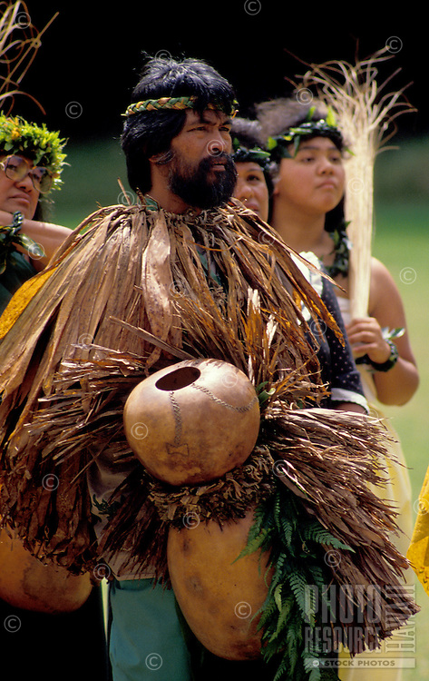 "EDITORIAL ONLY. Hula dancer holding """"ipuheke"""" gourd instrument"