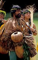 "EDITORIAL ONLY. Hula dancer holding """"ipuheke"""" gourd instrument"