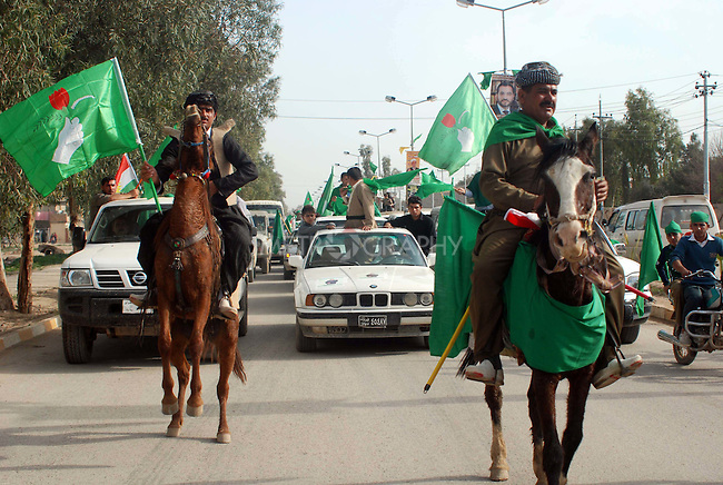 KELAR, IRAQ: Horsemen ride through the city streets flying the P.U.K. flag in a election campaign parade in the Kurdish city of Kelar...A parade arranged by P.U.K, one of the political parties in Kurdistan Alliance List takes place in the Kurdish city of Kelar.  The Iraqi Parliamentary Elections due to be held March 7th, 2010...Photo by Dashti Anwar/ Metrogrphy