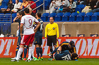 A Los Angeles Galaxy trainer treats Juninho (19) during the first half against the New York Red Bulls during a Major League Soccer (MLS) match at Red Bull Arena in Harrison, NJ, on May 19, 2013.