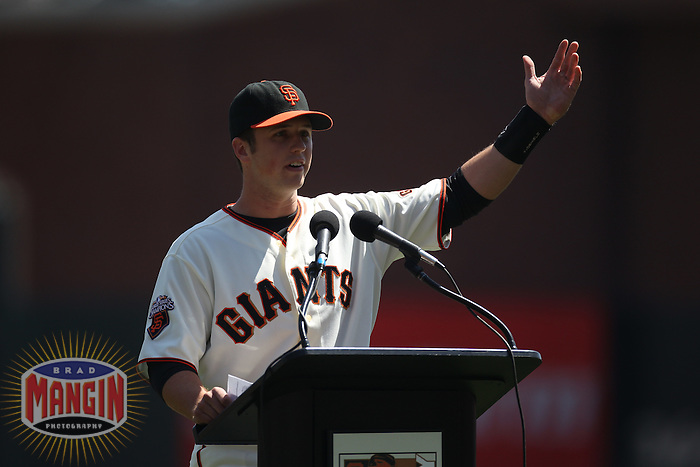 SAN FRANCISCO - APRIL 10:  Buster Posey #28 of the San Francisco Giants speaks to the fans during the ceremony in which Posey is presented with the 2010 National League Rookie of the Year award and Players Choice award before the game against the St. Louis Cardinals at AT&T Park on April 10, 2011 in San Francisco, California. Photo by Brad Mangin