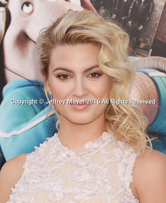 LOS ANGELES, CA - DECEMBER 03: Singer/actress Tori Kelly arrives at the Premiere Of Universal Pictures' 'Sing' at the Microsoft Theater at L.A. Live on December 3, 2016 in Los Angeles, California.