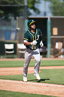 Oakland Athletics first baseman Alfonso Rivas (26) jogs down the first base line after hitting a home run during an Instructional League game against the Los Angeles Dodgers at Camelback Ranch on October 4, 2018 in Glendale, Arizona. (Zachary Lucy/Four Seam Images)
