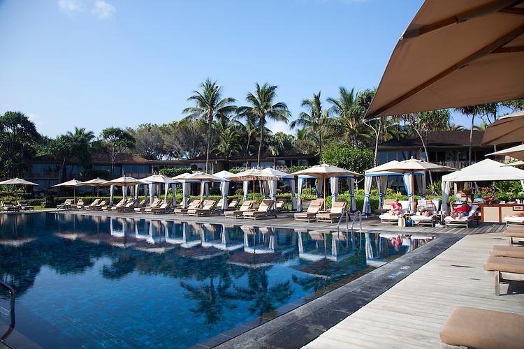 The Four Seasons Resort Hualalai at Historic Kaupulehu on the Big Island of Hawaii. The Cabana lined Beach Tree Pool.