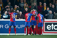 Conor Wilkinson of Dagenham scores the first goal for his team and celebrates in front of the away fans during Dagenham & Redbridge vs Sutton United, Vanarama National League Football at the Chigwell Construction Stadium on 23rd February 2019