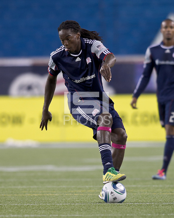 New England Revolution midfielder Shalrie Joseph (21) at midfield.  In a Major League Soccer (MLS) match, the Columbus Crew defeated the New England Revolution, 3-0, at Gillette Stadium on October 15, 2011.