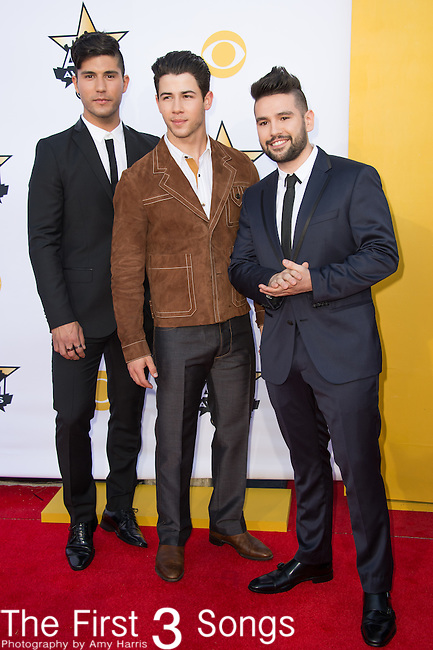 Nick Jonas poses with Dan Smyers and Shay Mooney of Dan + Shay at the 50th Academy Of Country Music Awards at AT&T Stadium on April 19, 2015 in Arlington, Texas.