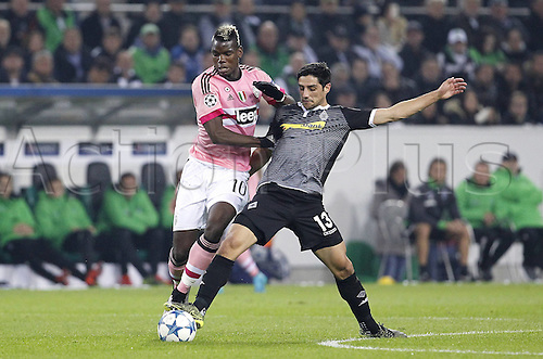 03.11.2015. Moenchengladbach, Germany, UEFA Champions League football group stages. Borussia Moenchangladbach versus Juventus.  Paul Pogba (Juventus Turin) challenges Lars Stindl (Moenchengladbach)
