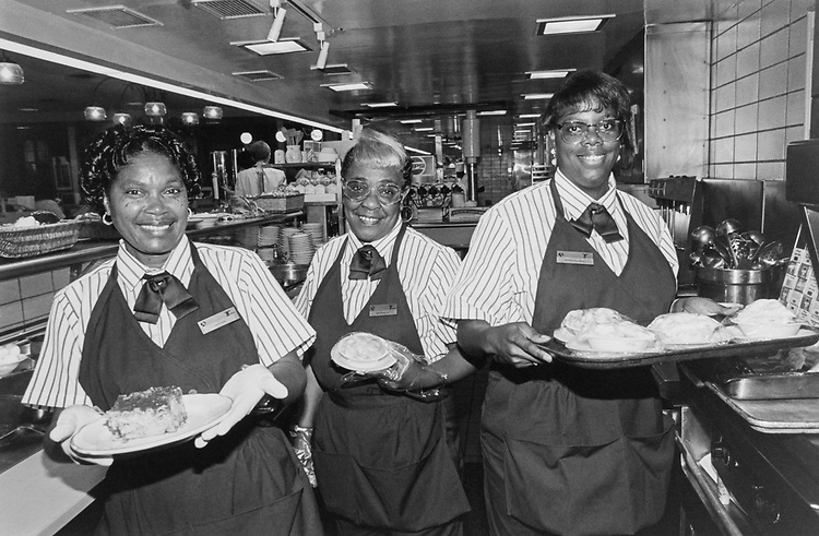 Julia Prater (Line Server, Grill cook), Bernicespain (salad girl) and Patrena Edmondson (line girl), wearing the new uniforms in red and blue stripes on white background, necktie and navy pants on July 12, 1994. (Photo by Maureen Keating/CQ Roll Call via Getty Images)