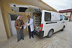 Yusef Gorges, a 66-year old internally displaced Christian, gets a prescription filled by Pharmacist Aodeshu Yanan during the visit of a mobile clinic to the village of Sharafiya, Iraq, which was flooded with displaced families when the Islamic State group took over nearby portions of the Nineveh Plains in 2014. The clinic is a program of the Christian Aid Program Nohadra - Iraq (CAPNI). Yanan was also displaced by ISIS.