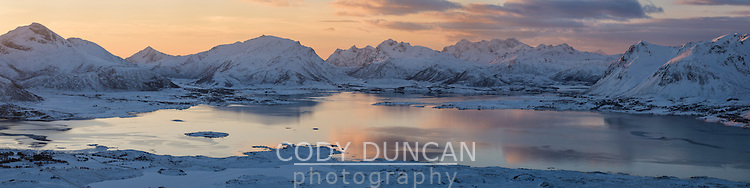 Winter view over coast and mountains from summit of Hoven, Gimsøy, Lofoten Islands, Norway
