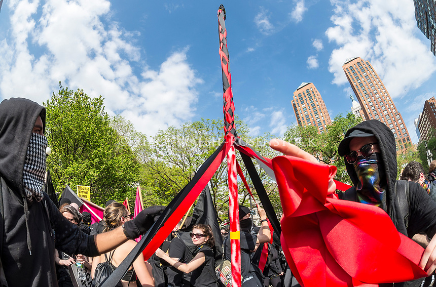 New York, NY 1 May 2017 - Anarchists dance around a Maypole  at a May Day rally for Inernational Workers Day in Union Square Park. ©Stacy Walsh Rosenstock/Alamy Live News