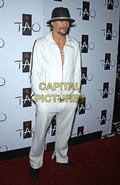 """Kid Rock (Robert James """"Bob"""" Ritchie) .Kid Rock concert afterparty at Tao Nightclub inside The Venetian, Las Vegas, Nevada, USA..January 28th, 2012.full length white trousers jacket hat black hands in pockets .CAP/ADM/MJT.© MJT/AdMedia/Capital Pictures."""