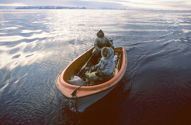 Inuit hunters Jens & Tukak return from an autumn hunt in a boat. Moriussaq. Greenland.