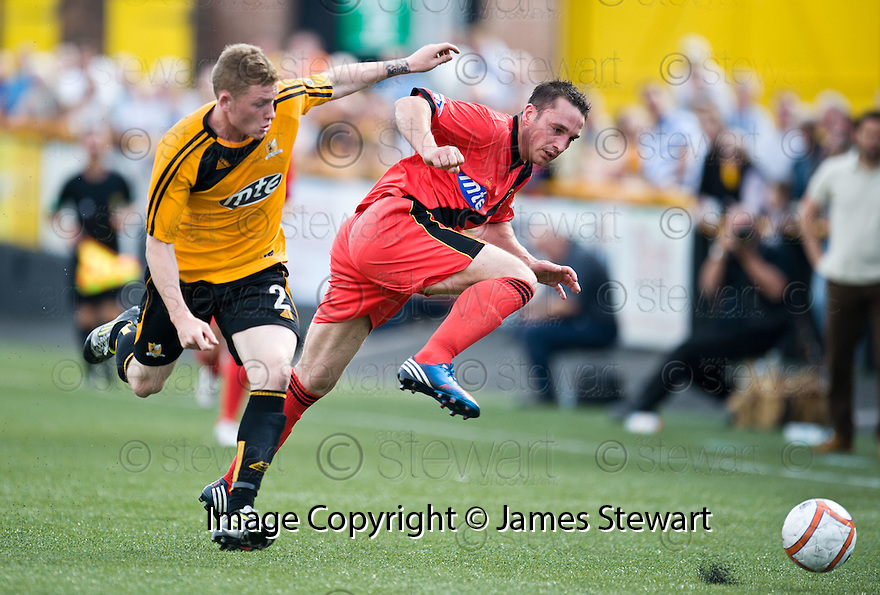 Alloa's James Doyle and East Fife's Gareth Wardlaw challenge for the ball.
