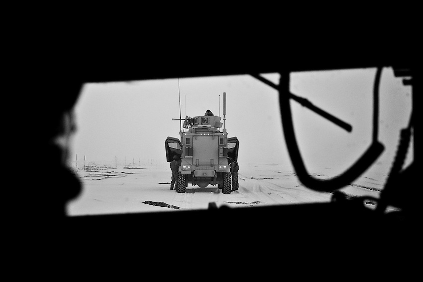 Members of Baker Company, 1st Battalion, 506th Infantry, step outside an MRAP military vehicle en route to a clearing operation in the village of Ebrahim, Mota Khan District, Paktika Province, Afghanistan, Friday, January 23, 2009. The harsh terrain and winters in the mountains of Afghanistan make the logistics of carrying out military operations quite difficult.