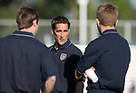U.S. forward Josh Wolff (center) talks with teammates Steve Ralston (l) and Taylor Twellman (r) on Tuesday, April 11th, 2006 at SAS Stadium in Cary, North Carolina. The United States Men's National Team tied Jamaica 1-1 in a men's international friendly.