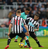 4th November 2017, St James Park, Newcastle upon Tyne, England; EPL Premier League football, Newcastle United Bournemouth; Joshua King of AFC Bournemouth holds off a challenge from Christian Atsu and Matt Ritchie of Newcastle United in the first half
