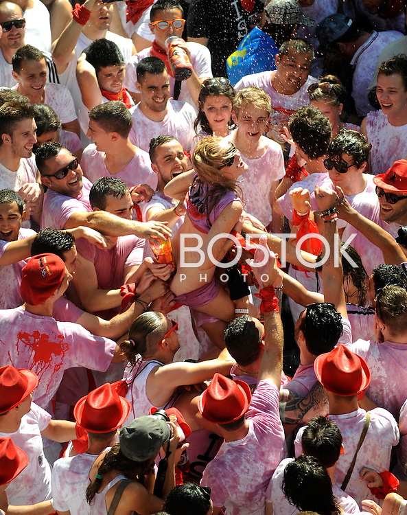 People celebrates the openning of San Fermin Festival with a rocket, the Chupinazo, on July 6, 2013, in Pamplona, Basque Country. On each day of the eight San Fermin festival days six bulls are released at 8:00 a.m. (0600 GMT) to run from their corral through the narrow, cobbled streets of the old navarre town over an 850-meter (yard) course. Ahead of them are the runners, who try to stay close to the bulls without falling over or being gored. (Ander Gillenea / Bostok Photo)