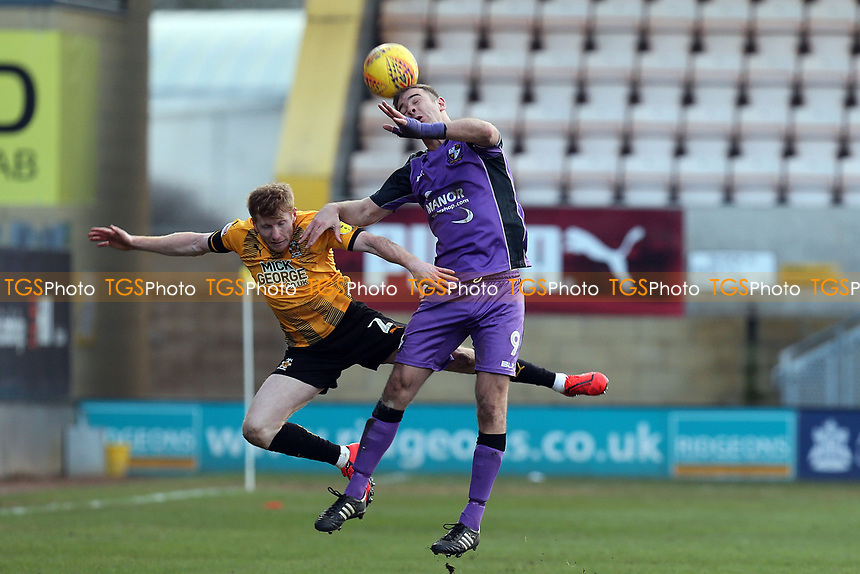 Tom Pope of Port Vale and Brad Halliday of Cambridge United during Cambridge United vs Port Vale, Sky Bet EFL League 2 Football at the Cambs Glass Stadium on 9th February 2019