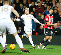 Yoann Barbet of Brentford puts in a cross during the Sky Bet Championship match between Brentford and Leeds United at Griffin Park, London, England on 4 November 2017. Photo by Carlton Myrie.
