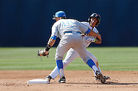 Pat Valaika #10 of the UCLA Bruins gets entangled with Richy Pedroza #6 of the Cal State Fullerton Titans after tagging him out at second base during the NCAA Super Regional at Goodwin Field on June 7, 2013 in Fullerton, California. UCLA defeated Cal State Fullerton, 5-3. (Larry Goren/Four Seam Images)
