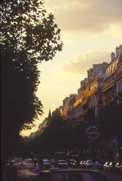 Paris, France, Boulevard St Germain, 6th Arrondissement, garrets and rooftops of Paris at sunset,
