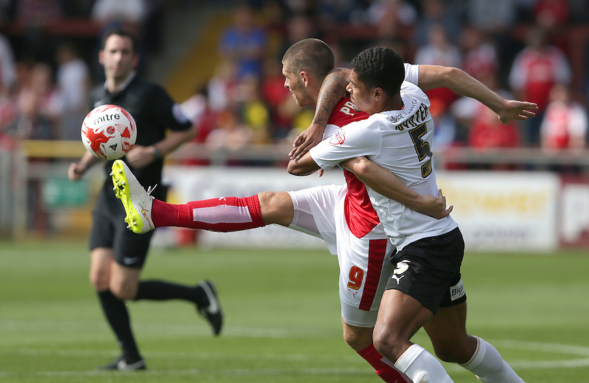 Fleetwood Town's Jamie Proctor and Colchester United's Alex Wynter<br /> <br /> Photographer Stephen White/CameraSport<br /> <br /> Football - The Football League Sky Bet League One - Fleetwood Town v Colchester United - Saturday 22nd August 2015 - Highbury Stadium - Fleetwood<br /> <br /> &copy; CameraSport - 43 Linden Ave. Countesthorpe. Leicester. England. LE8 5PG - Tel: +44 (0) 116 277 4147 - admin@camerasport.com - www.camerasport.com