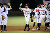 Joel Booker (23) of the Kannapolis Intimidators high fives his teammates after their win over the Hagerstown Suns at Kannapolis Intimidators Stadium on June 14, 2017 in Kannapolis, North Carolina.  The Intimidators defeated the Suns 10-1 in game two of a double-header.  (Brian Westerholt/Four Seam Images)