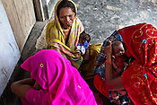 Local village women meet for vaccination and immunization of their infants at the Anganwadi centre in Khantari Mahanand Village, in Muzaffarpur, Bihar. Since 2008 the Foundation and Geneva Global have been investing in the training of medical staff to improve the lives of people living in 600+ villages in the region. The NGOs are delivering cost effective interventions to address treatment, care and prevention of diseases, disability and preventable deaths amongst infants, adolescent girls and women of child-bearing age. There is statistical and anecdotal evidence that there have been vast improvements and a total of 40-50% increased immunization for all children under 6 has meant that communities can be serviced and educated long term. Photograph: Sanjit Das/Panos for Legatum Foundation