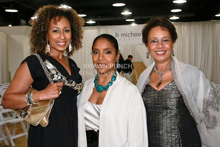 Actress Tamara Tunie (left), actress Phylicia Rashad (center), and costume designer Myrna Colley-Lee (right) attend the b michael AMERICA Couture Spring 2012 runway show, during Mercedes-Benz Fashion Week Spring 2012; Septeber 24 2011.