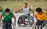 Manuel Rios dribbles the basketball while pushing his wheelchair forward during practice in Zipolite, a town in Oaxaca, Mexico. Rios plays on the Oaxaca Costa wheelchair basketball team.