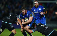 28th February 2020; RDS Arena, Dublin, Leinster, Ireland; Guinness Pro 14 Rugby, Leinster versus Glasgow; Peter Dooley (Leinster) is tackled hard by Aki Seiuli (Glasgow Warriors) and D'Arcy Rae (Glasgow Warriors)