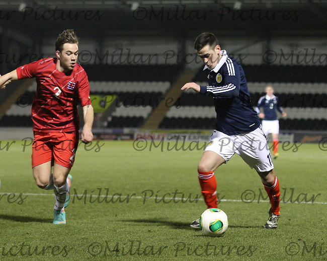Jamie Walker takes on Tom Laterza in the Scotland v Luxembourg UEFA Under 21 international qualifying match at St Mirren Park, Paisley on 25.3.13.