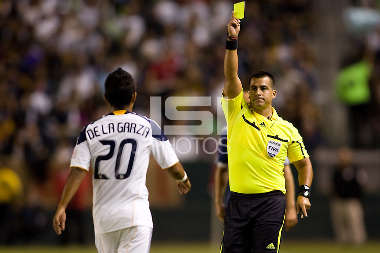 LA Galaxy defender A.J. DeLaGarza is shown the yellow card from referee Ricardo Salazar. The New York Red Bulls beat the LA Galaxy 2-0 at Home Depot Center stadium in Carson, California on Friday September 24, 2010.