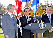 Camp David, MD - October 18, 2008 --  President Nicolas Sarkozy of France, who also serves as this year's rotating President of the European Union (EU), center, makes remarks as United States President George W. Bush, left, and President José Manuel Barroso of the European Commission (EC), right, look on at the Presidential Retreat near Thurmont, Maryland for talks on Saturday, October 18, 2008.  The two European leaders stopped at Camp David to meet with President Bush to discuss the economy on their way home from a summit in Canada to try to convince Bush to support a summit by year's end to try to reform the world financial system..Credit: Ron Sachs / Pool via CNP
