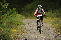 NWA Democrat-Gazette/ANDY SHUPE<br /> Jarod Yarbrough of Alexander rides across Lee Creek Saturday, Sept. 19, 2015, during the Northwest Arkansas Mountain Bike Championships at Devil's Den State park.