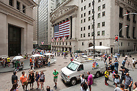 Hordes of tourists, downtown workers and the media in front of the New York Stock Exchange on Wednesday, July 8, 2015. What is being described as a technical problem halted trading on the exchange at 11:32 AM which eventually resumed at about 3:10 PM after being out for about three and one half hours.  (© Richard B. Levine)