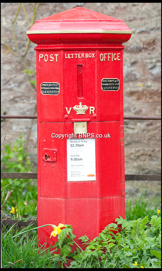 BNPS.co.uk (01202) 558833<br /> Picture: LauraJones/BNPS<br /> <br /> Red letter day for England's oldest post box as it once again becomes the pillar of the community...<br /> <br /> England's oldest postbox in Holwell, Dorset.<br /> <br /> The oldest post box in England has had its red letter day after being spruced up with a new lick of paint and returned to its former glory.<br /> <br /> The iconic box was built in 1855 and is an unusual 'Butt' type design, which means it is an octagonal shape instead of cylindrical.<br /> <br /> It also has a vertical slot for letters to be dropped in instead of the horizontal ones we see today.<br /> <br /> The bright red box has stood on a roadside in Holwell near Sherborne, Dorset, for almost 160 years and was suffering from flaking paint and rust.