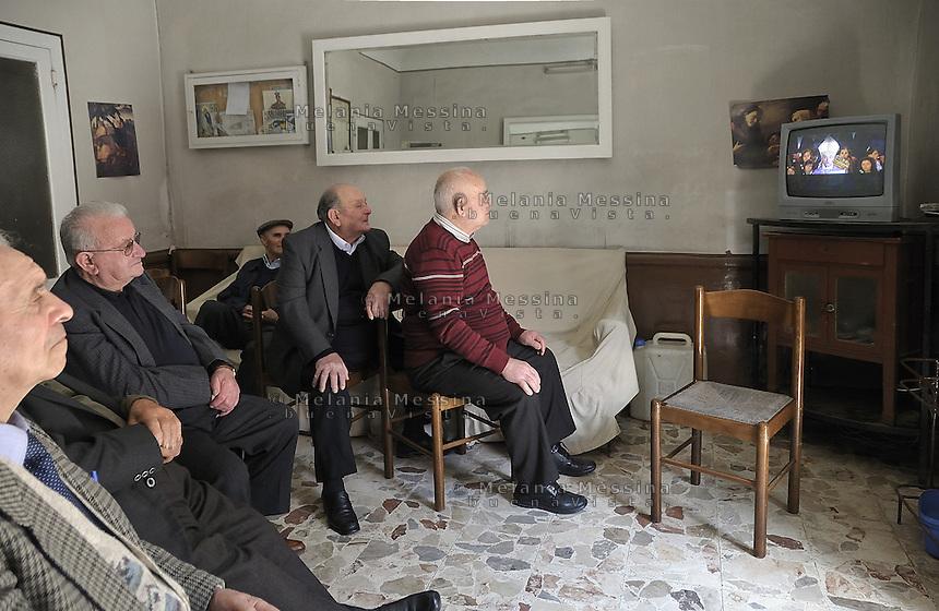 Corleone, during celebrations of the state funeral of Placido Rizzotto, old men watching the event on television.<br /> <br /> Corleone, durante le celebrazioni dei funerali di stato di Placido Rizzotto, anziani nei circoli assistono ai funerali in televisione.