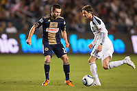 LA Galaxy midfielder David Beckham (23) moves to saves a ball from Philadelphia forward Jack McInerney (29). The LA Galaxy defeated the Philadelphia Union 1-0 at Home Depot Center stadium in Carson, California on  April  2, 2011....