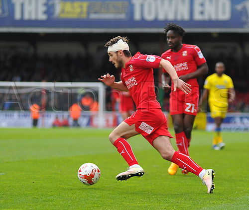 April 14th 2017, County Ground, Swindon, Wiltshire; Skybet league 1 football, Swindon Town versus AFC Wimbledon; John Goddard, midfielder for Swindon Town brings the ball forward