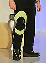 """November 1, 2011, Tokyo, Japan - Strapping the computerized metallic brace onto his right leg, Eiichi Saito, a professor in rehabilitation medicine, demonstrates the """"walk assist"""" device he has co-developed with Toyota at its facility in Tokyo on Tuesday, November 1, 2011, as the auto maker unveiled experimental robots aimed for commercialization from 2013 to the media. Prof. Saito, whose right leg was paralyzed by polio, walked up and down a flight of stairs and showed how the brace could bend at knee as needed, allowing him to walk more naturally. Toyota also demonstrated an intelligent machine with padded arms that can help health care workers lift disabled patients from their beds and then carry them around. Another mobility aid worked like a skateboard to help people relearn balance. (Photo by Natsuki Sakai/AFLO) [3615] -mis-"""