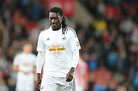 Sunday, 19 October 2014<br /> Pictured: Bafetimbi Gomis of Swansea City looks dejected as he leaves the pitch at full time<br /> Re: Barclay's Premier League, Stoke City FC v Swansea City FC v at Britannia Stadium, Stoke, Staffordshire,UK.
