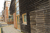 Recycled wood cladding on a building at the Beddington Zero Energy Development (BedZED) in the London Borough of Sutton.  The highly insulated development was built using locally sourced materials.  BedZED, the UK's largest carbon-neutral eco-community, comprises 82 mixed tenure housing units, managed by the Peabody Trust, and north-facing offices.