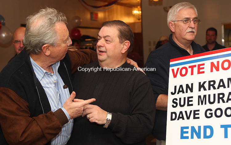 Plymouth, CT-11062007MK02 Former mayor Richard Covello congratulates Vincent Festa Jr. as they learn the results of the Mayoral election in Plymouth Tuesday night.  Festa defeated the incumbent Jan A. Krampitz easily 1905 to 656 votes.  Michael Kabelka / Republican-American   ()CQ