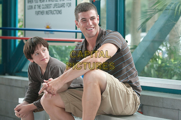 NATHAN GAMBLE & AUSTIN STOWELL.in Dolphin Tale.*Filmstill - Editorial Use Only*.CAP/FB.Supplied by Capital Pictures.