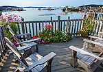 Stonington, ME: Wood deck with adironadack chairs and potted summer flowers overlooking Stonington Harbor