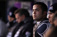 Scranton Wilkes-Barre Yankees catcher Jesus Montero #21 in the dugout during a game against the Rochester Red Wings at Frontier Field on April 12, 2011 in Rochester, New York.  Scranton defeated Rochester 5-3.  Photo By Mike Janes/Four Seam Images